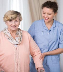 staff assisting elder woman