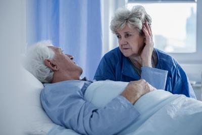 elderly couple talking