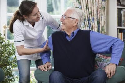 caregiver assisting elder man